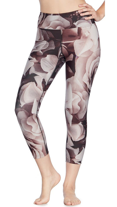 close up front view of vintage floral themed printed capri leggings