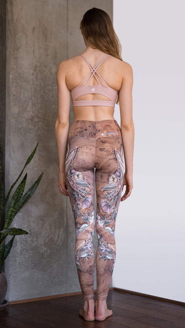 closeup back view of model wearing full length leggings with printed jackalope design