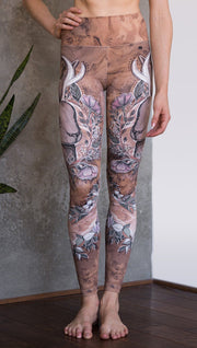 closeup front view of model wearing full length leggings with printed jackalope design