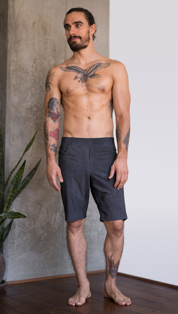 front view of model wearing charcoal black printed mens performance shorts
