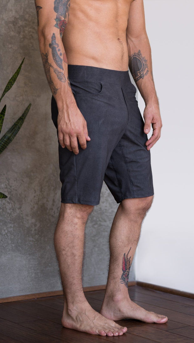closeup right side view of model wearing charcoal black printed mens performance shorts
