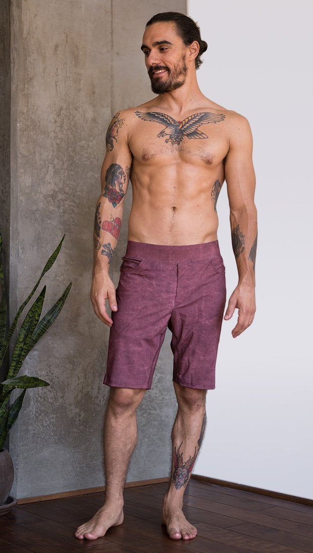 front view of model wearing brick red printed mens performance shorts