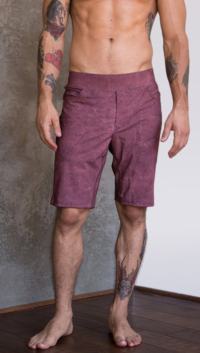 closeup front view of model wearing brick red printed mens performance shorts