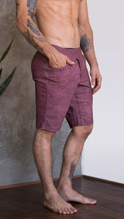 closeup right side view of model wearing brick red printed mens performance shorts