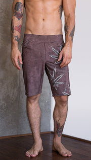 closeup front view of model wearing cannabis inspired printed mens performance shorts