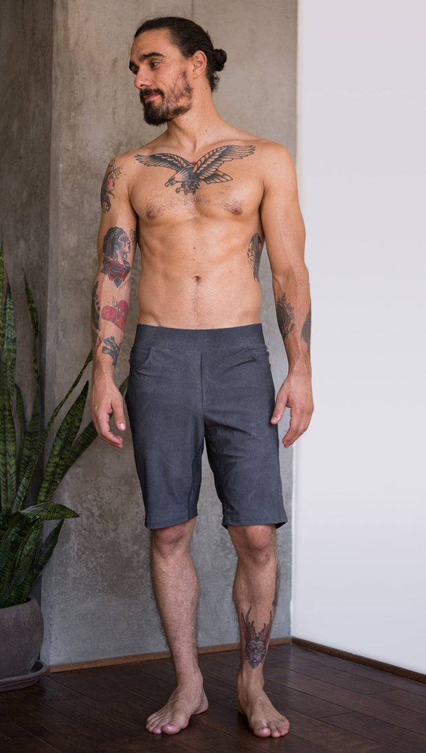 front view of model wearing gray mens performance shorts