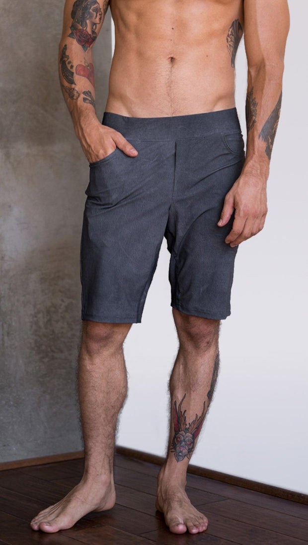 close up front view of model wearing gray mens performance shorts