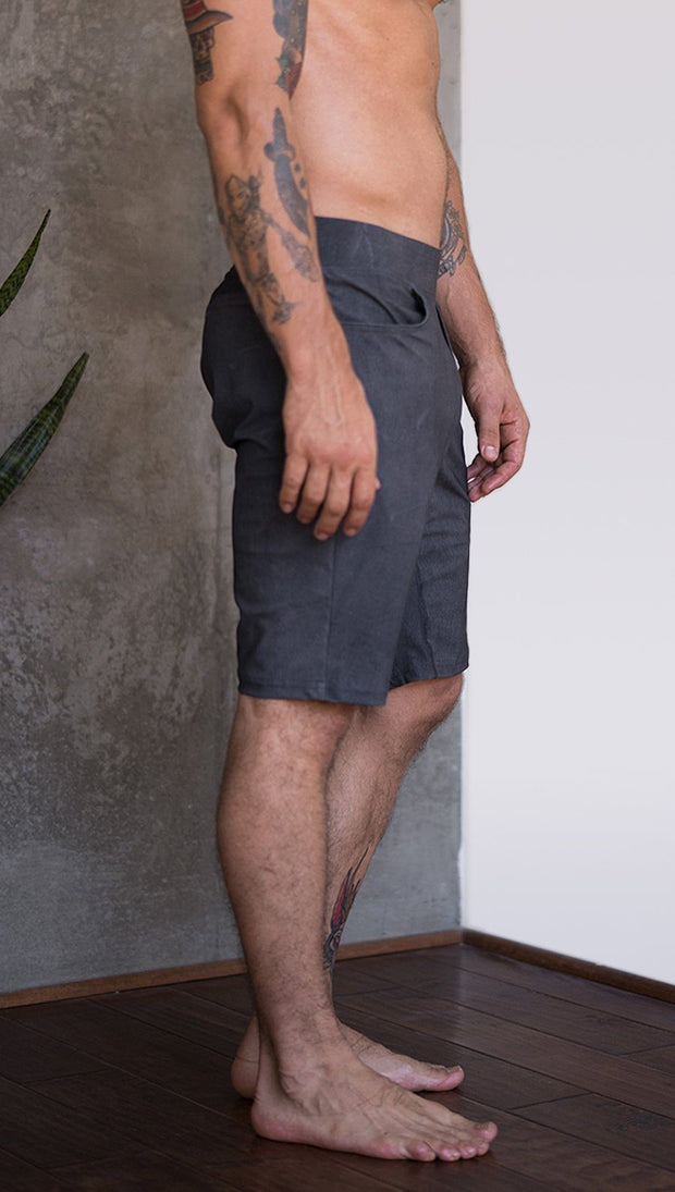 close up right side view of model wearing gray mens performance shorts