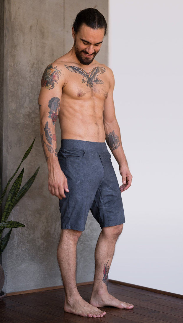 right side view of model wearing slate mens performance shorts