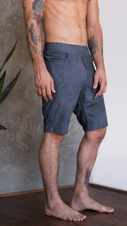 closeup right side view of model wearing slate mens performance shorts