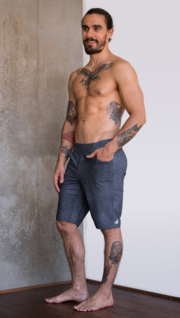 left side view of model wearing slate mens performance shorts