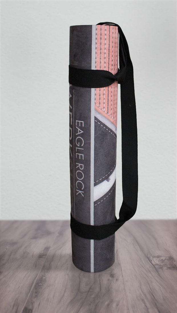 view of rolled up motocross inspired yoga fitness mat
