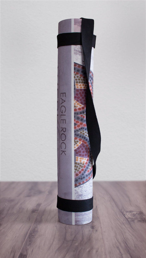 view of rolled up sugar skull yoga mat