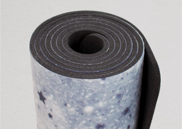 closeup view of rolled up moon cycle themed yoga mat