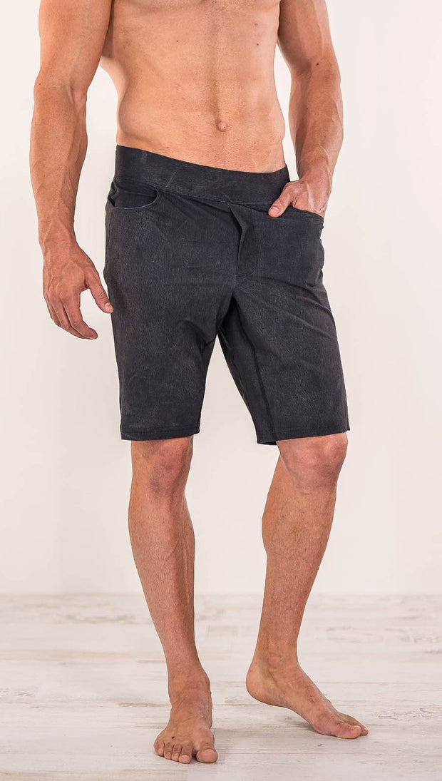 Close up front view of model wearing charcoal black printed men's performance shorts