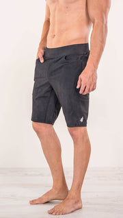 Close up right side view of model wearing charcoal black printed men's performance shorts