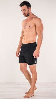 Right side view of model wearing black men's performance shorts