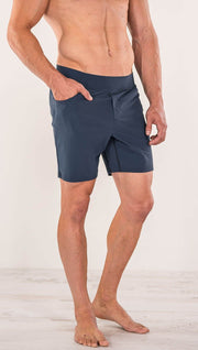 Close up left side view of model wearing black men's performance shorts