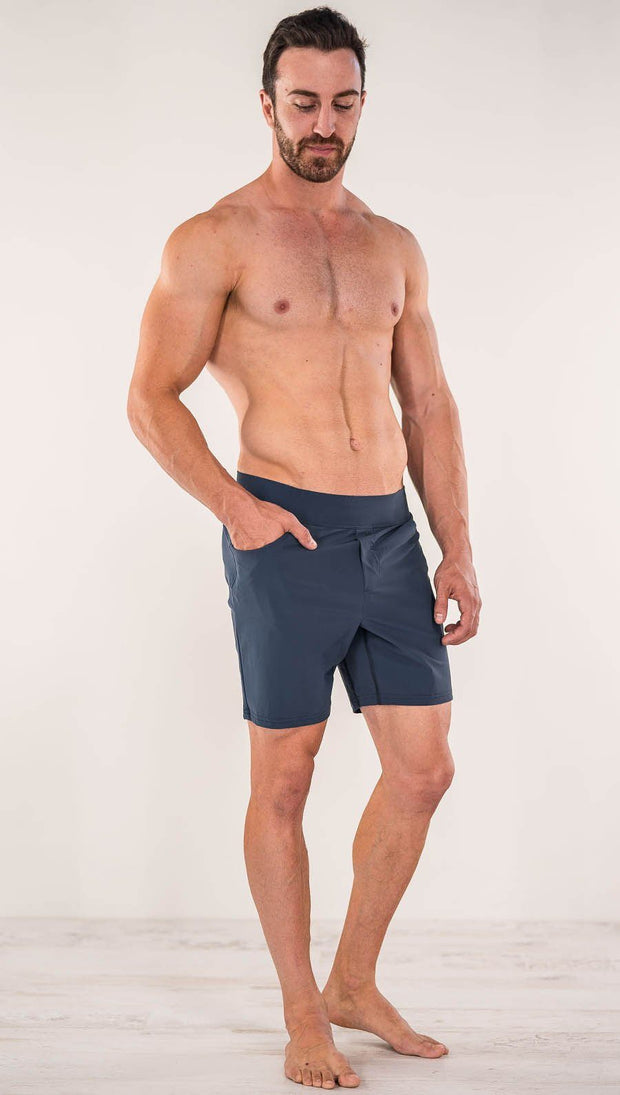 Front view of model wearing black men's performance shorts