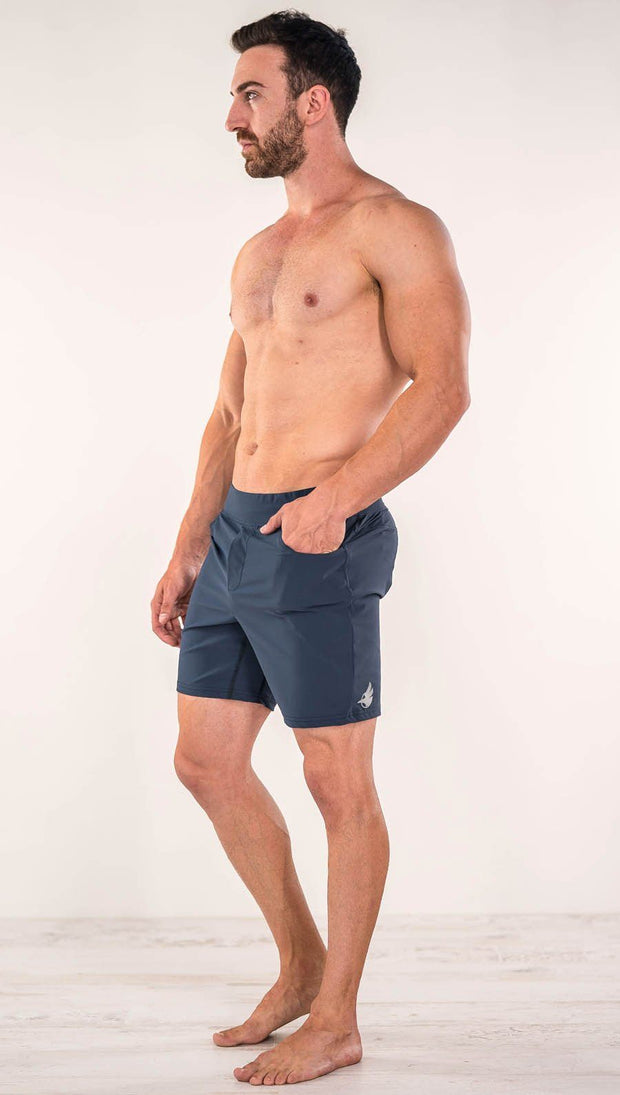 Left side view of model wearing black men's performance shorts