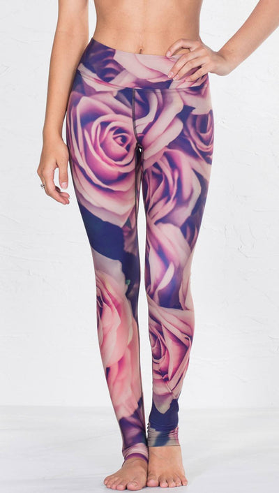 close up front view of model wearing printed full length leggings with all-over rose design motif