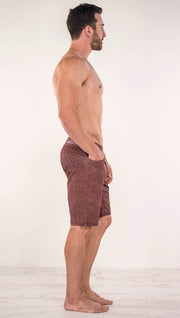 Right side view of model wearing brick red printed men's performance shorts