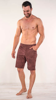 Front view of model wearing brick red printed men's performance shorts