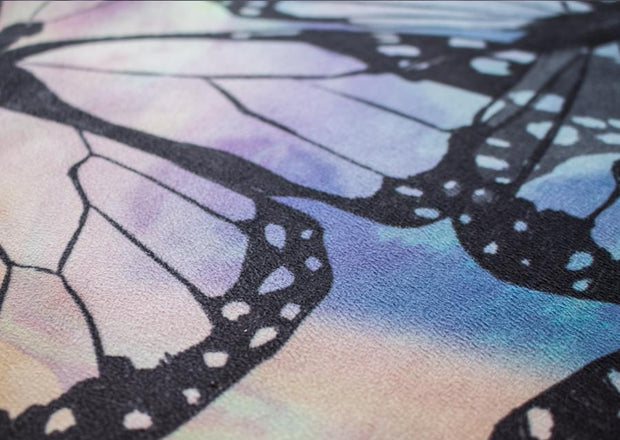 closeup view of colorful butterfly themed printed yoga mat