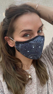 Right side view of model wearing a dark blue mosaic themed mask