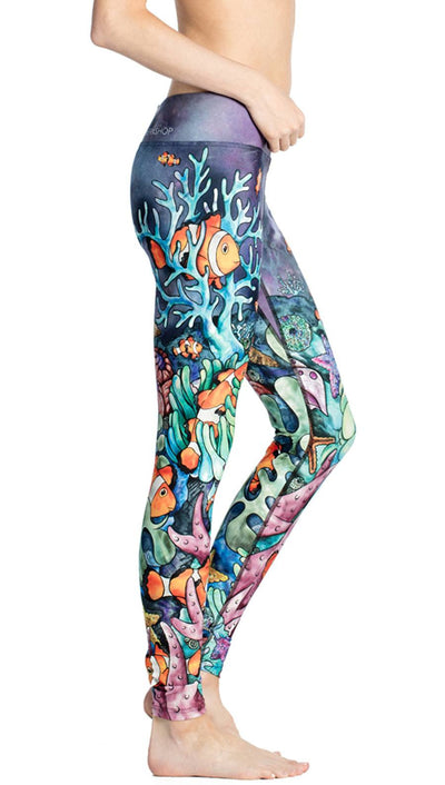 close up side view of coral reef themed printed full length leggings