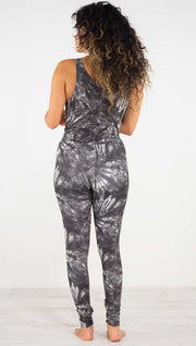 Back view of model wearing the charcoal spiral athleisure leggings. They are in a charcoal color with white tie dye spirals throughout the leggings.