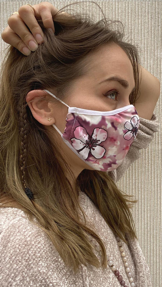 Right side view of model wearing a pink cherry blossom mask