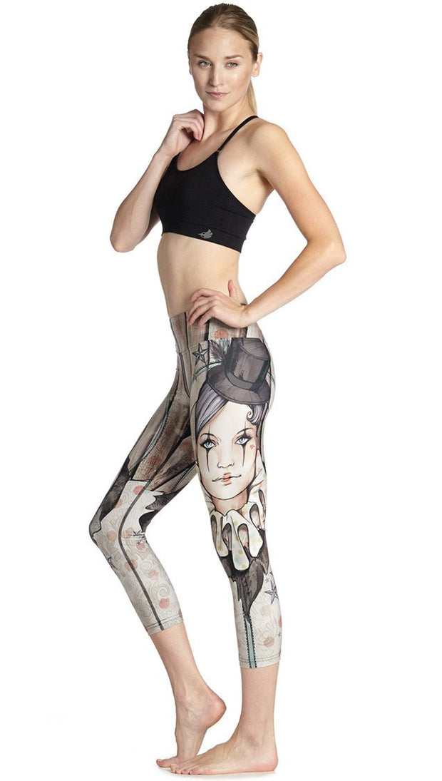 left side view of model wearing circus girl themed printed capri leggings