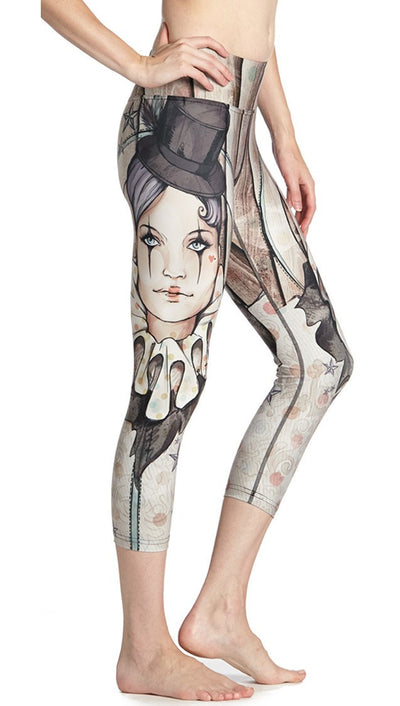 close up side view of model wearing circus girl themed printed capri leggings