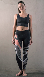 front view of model wearing striped coral moto themed printed full length leggings