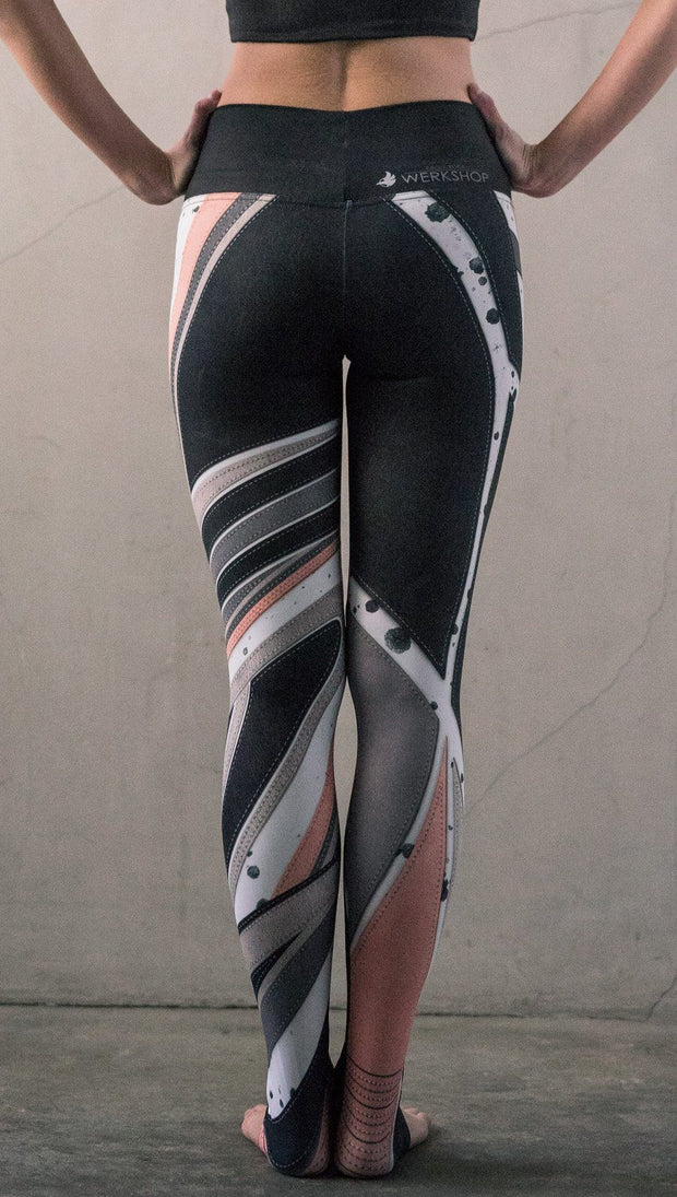 back view of model wearing striped coral moto themed printed full length leggings