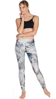 front view of model wearing flying crane themed printed full length leggings