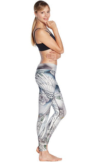 right side view of model wearing flying crane themed printed full length leggings