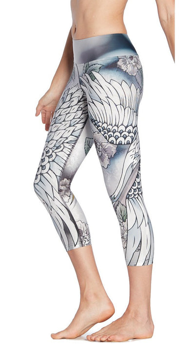 close up side view of flying crane themed printed capri leggings