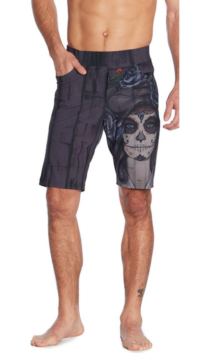 front view of dark sugar skull inspired printed mens shorts