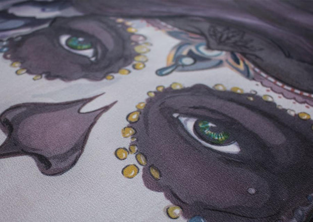 closeup view of design of sugar skull themed yoga mat