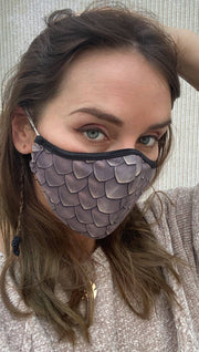 Right side view of model wearing a brown dragon scales mask