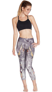 front view of model wearing dreamcatcher themed printed capri leggings