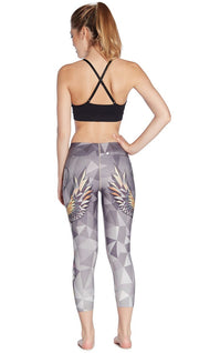 back view of model wearing dreamcatcher themed printed capri leggings