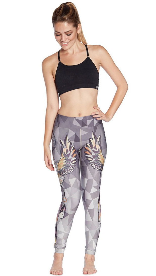 front view of model wearing dreamcatcher themed printed full length leggings