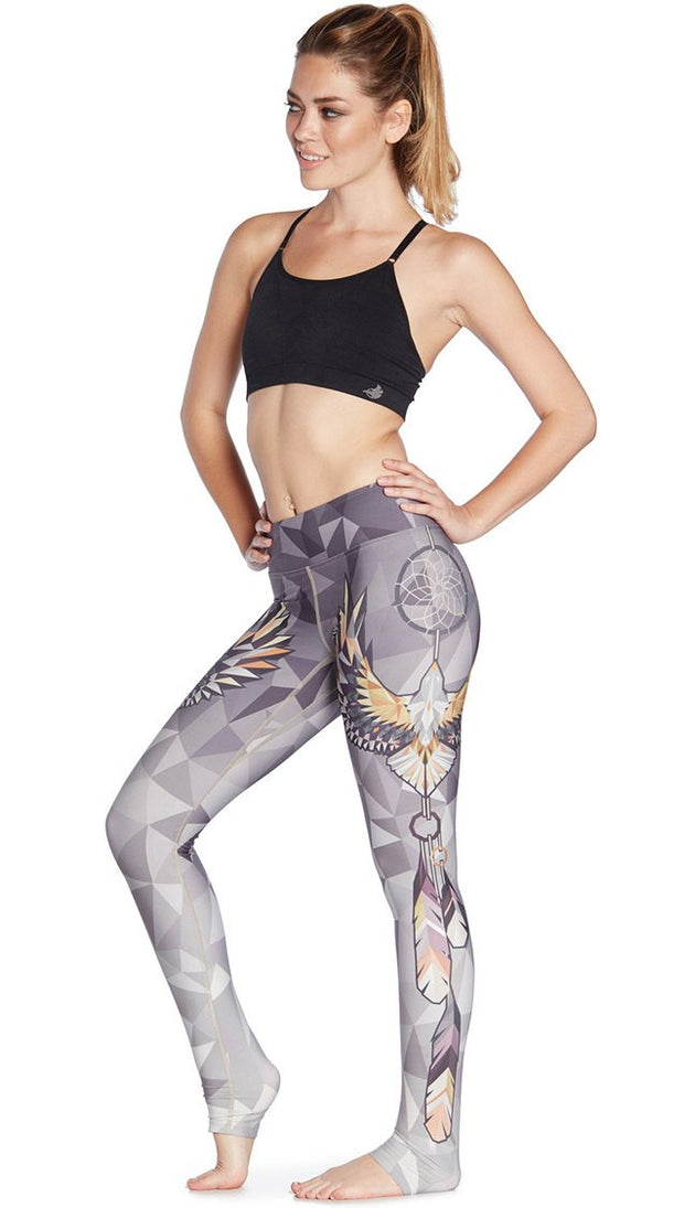 left side view of model wearing dreamcatcher themed printed full length leggings