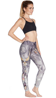 right side view of model wearing dreamcatcher themed printed full length leggings