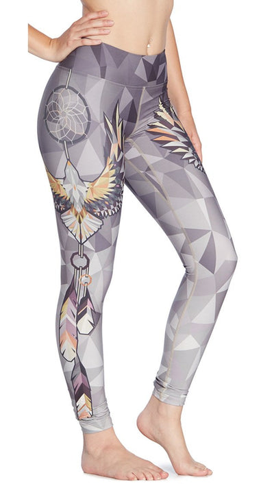 close up side view of dream catcher themed printed full length leggings
