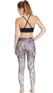 back view of model wearing dreamcatcher themed printed full length leggings