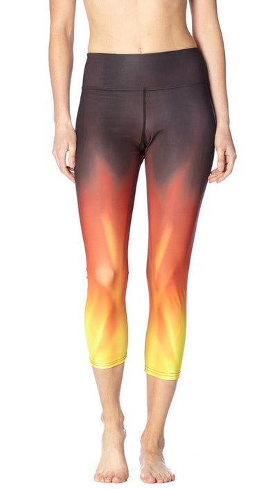 front view of fire themed printed capri leggings